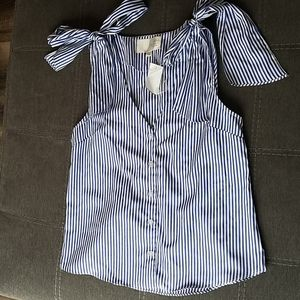 Blue/white striped, sleeveless top with should tie